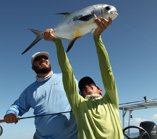 Fly Fishing for permit represents the pinnacle of the sport, worthy of much celebration when it happens.  Wayne celebrates his first caught off Key West.