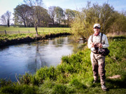 big ambitions with hands full of fly rods