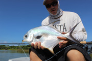 holding the neon triumph, a permit on fly!