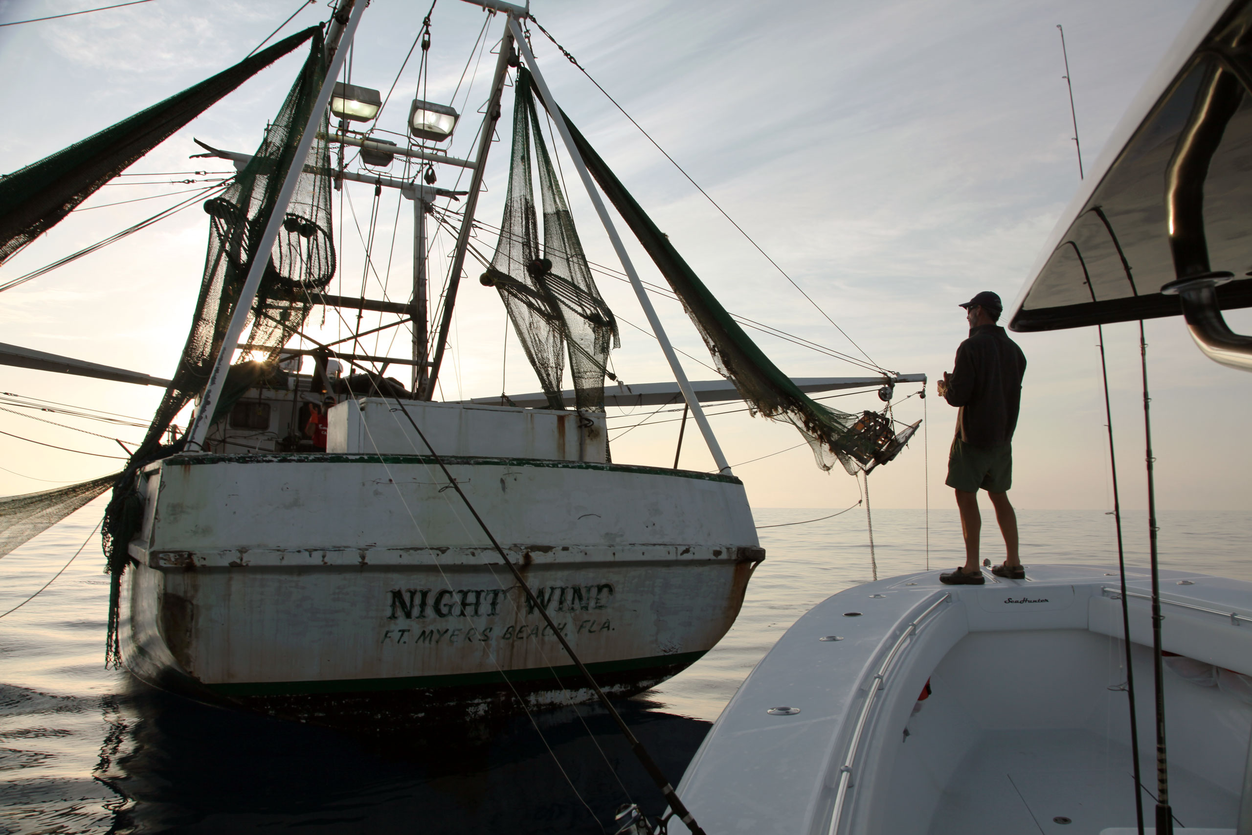 fishing behind the shrimp boats at dawn off Key West