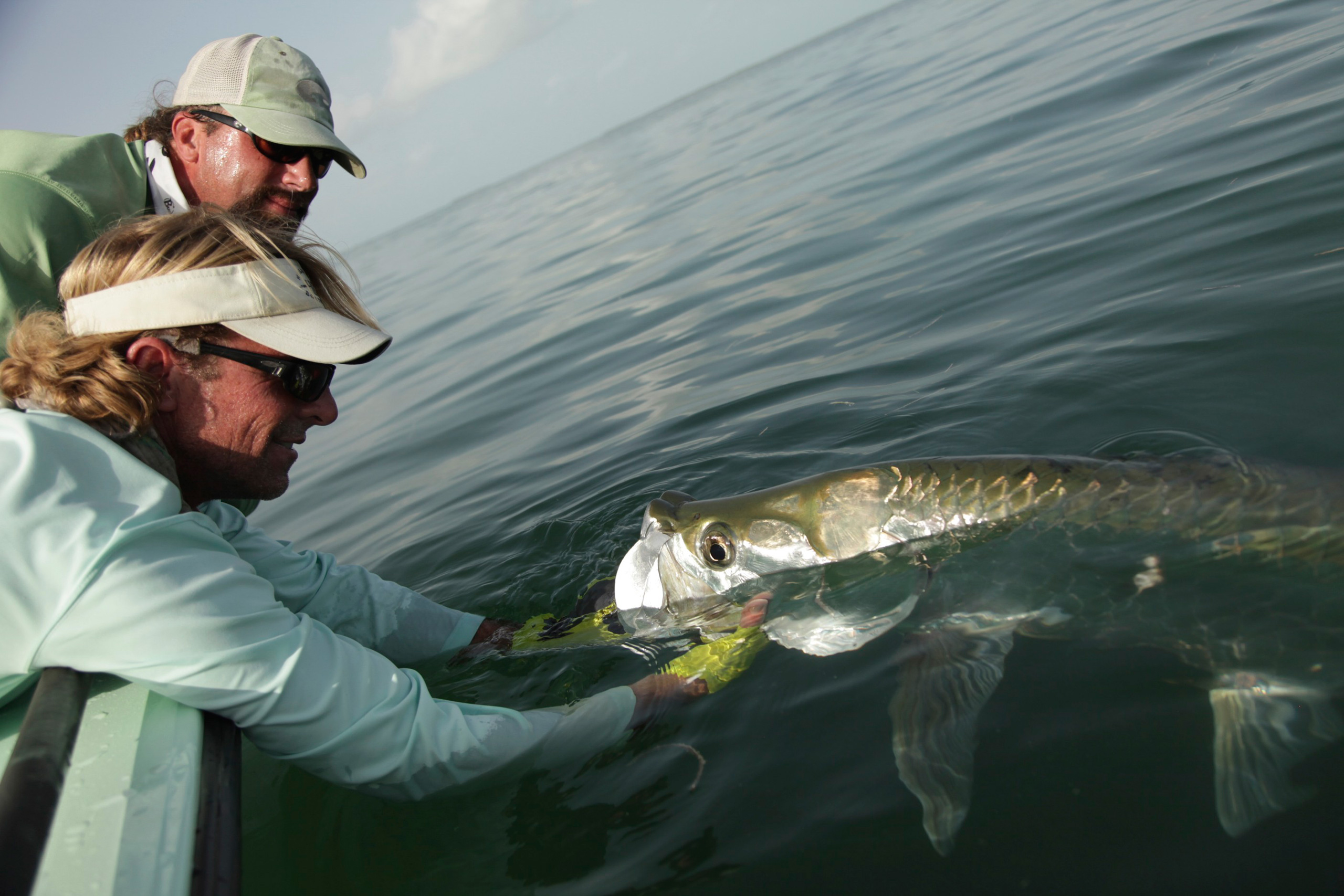 Capt. Jeff Legutki holds Capt. Shane Smith's Key West tarpon on fly.