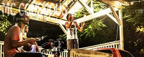 Mc Couscous performs on an outdoor stage in Key West, Fl