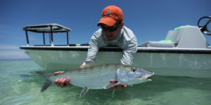an angler holds a big Islamorada bonefish he caught on fly in Florida bay