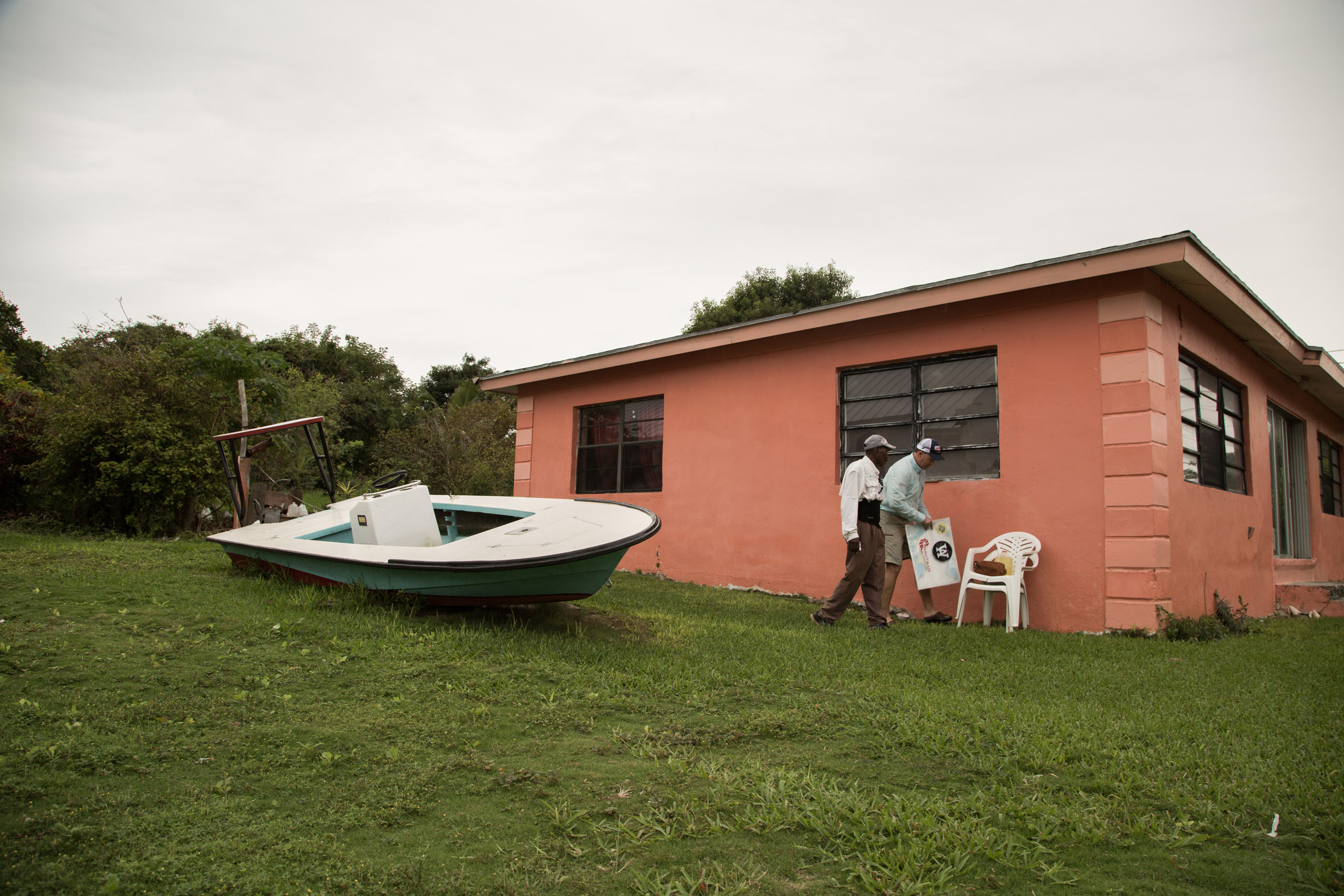 An old dolphin super skiff rests on it's side in McLeans town, East Grand Bahama