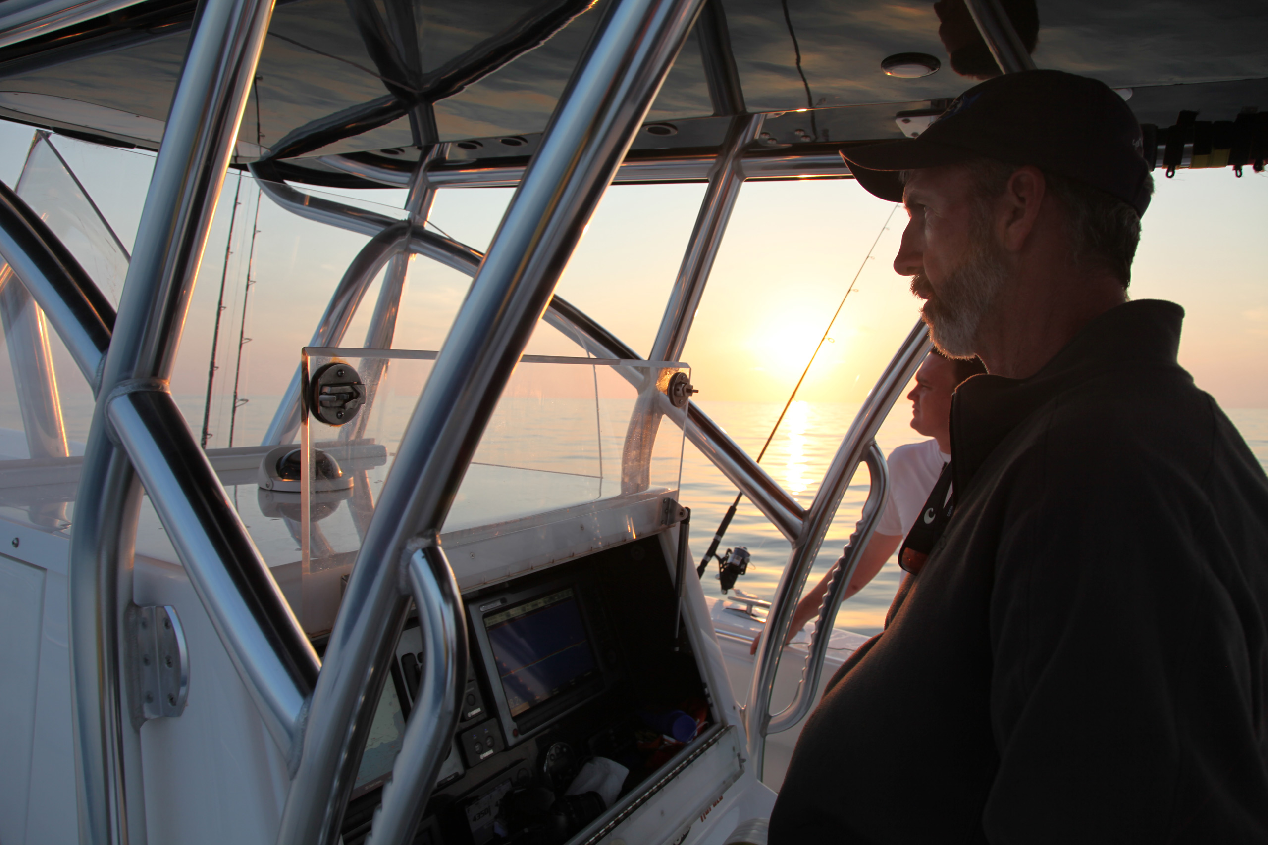 Capt Mike Wienhofer driving the boat out at sunrise