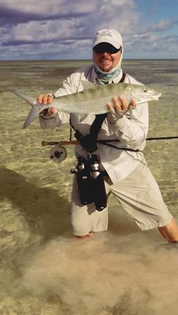 Captain Scott Irvine of Key West holds a big bonefish caught wading the flats of the bahamas